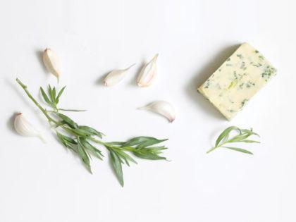 Butter with garlic petals and tarragon